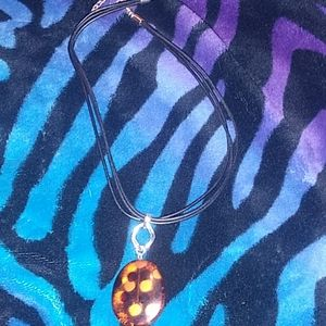 Brown polka dotted pendant necklace